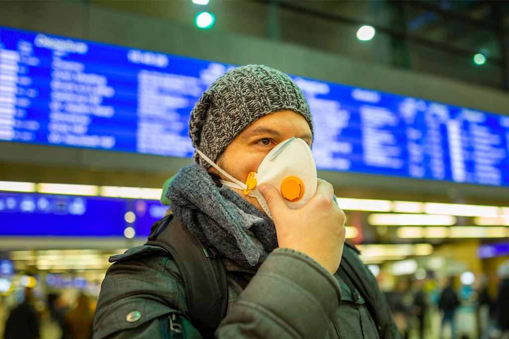 man with mask in an airport